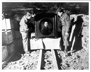 Harry Ettlinger (r.) salvaging a Rembrandt painting from a salt mine where it had been hidden to protect it from bombing (1945). Courtesy National Archives and Records Administration.