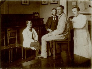 Dr. Felix Pinkus (r.) pictured with a patient and medical colleagues in 1897 Felix Pinkus Family Collection, AR 25456.