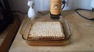 First, four to five matzos are moistened with wine until soft