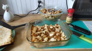 Second, a mixture of raisins apples, and almonds is layered between the matzos like a lasagna