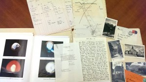 Folders from the Hoerlin collection. Visible are correspondence between Käte and Hermann Hoerlin, Herman Hoerlin's reports on the observation of nuclear tests from space, and a hand-drawn map of a region in Germany. AR 25540