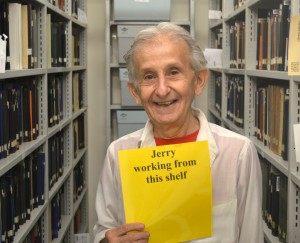 Jerry Brotman while barcoding books in the LBI library stacks.