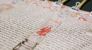 The Fürth Megillah drying under tension during conservation efforts at the CJH. Fürth Jewish Community Collection, AR 994