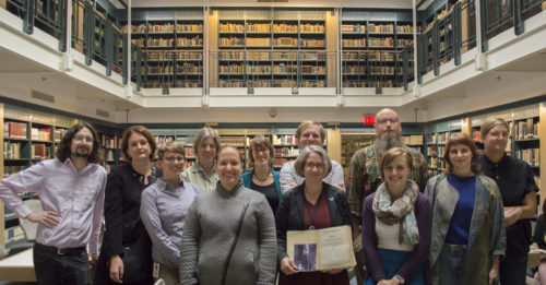 Employees of the LBI and the Center for Jewish History who worked on the reconstruction of the Freimann Collection. (From left) Ilya Slavutskiy, Renate Evers, Rachel Miller, Laura Leone, Moriah Amit, Lauren Paustian, Tracey Felder, Tim Conley, Eric Fritzler, Leanora Lange, Erica Magrey, Jennifer Rodewald. Not pictured: Ginger Barna, Albina Leibman-Klix, Shayna Marchese, Satoshi Tsuchiyama, Gloria Machnowski. Felder is holding an edition of the catalog published by Aron Freimann (inset) in 1932, which formed the basis for the team's work.